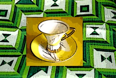 yellow-teacup-green-pattern-background