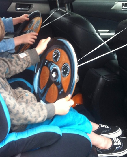 twins back seat drivers kids make car wheels